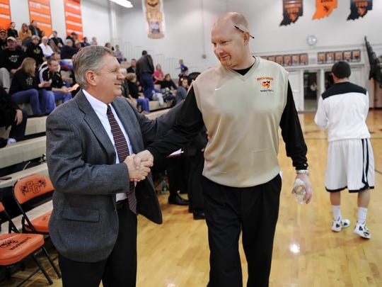 Beech Grove's Matt English gets a wink and a handshake from friend and Lapel coach Jimmie Howell before their game Dec. 16, 2011.