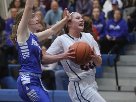 Michelle Sidor of Saddle River Day drives to the hoop