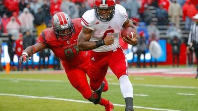 Rutgers won't have star defensive lineman Darius Hamilton (91) to chase down Wisconsin's ball-carriers on Saturday.