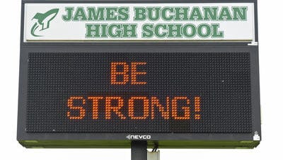 A message is seen on the marquee at James Buchanan High School, Wednesday, April 27, 2016. JBHS student Violet Clark died from injuries she suffered in a car accident on April 22, 2016.
