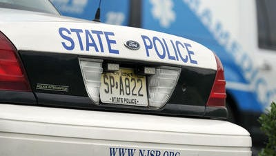 An unmarked  New Jersey State Police vehicle stolen from a trooper's driveway was used in two robberies and a theft, officials said.