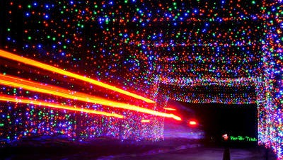 A car passes through a tunnel of Christmas lights at the Space Coast LIghtfest at Wickham Park. This year's event runs Nov. 20 to Jan. 1, 2019.