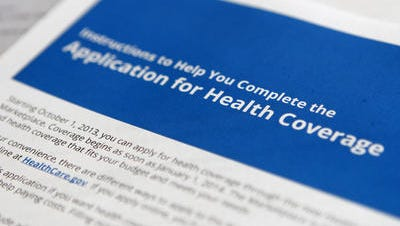 """Application and instructions paper work for the Health Insurance Marketplace from the Department of Health and Human Services as part of the Affordable Care Act, more popularly known as """"Obamacare."""""""