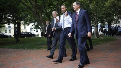 President Barack Obama and Vice President Joe Biden walk with former Procter & Gamble CEO Robert McDonald, Obama's nominee as the next Veterans Affairs secretary, from the Department of Veterans Affairs back to the White House June 30.