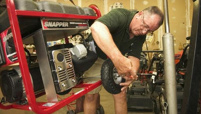 Gavin's Ace Home and Pro Powerhouse manager Jim Morse readied a new portable generator for delivery during a previous hurricane season.