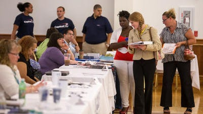 Job seekers attend a Middletown job fair last year. Delaware's jobless rate fell to 6 percent in February.