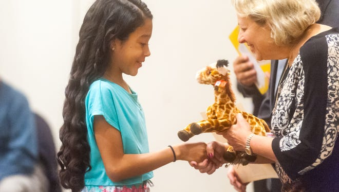D'Ippolito Elementary's Leylani Torres receives her Giraffe Award from Vineland Public Schools superintendent Dr. Mary Gruccio at Cumberland County College on Monday, May 22.