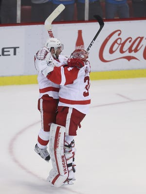 Red Wings goalie Petr Mrazek and left wing Tomas Tatar celebrate the 6-5 shoot-out win over the Boston Bruins on Wednesday, Jan. 18, 2017 at Joe Louis Arena.