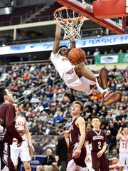 Northeastern's Brandon Coleman gets a two-handed dunk