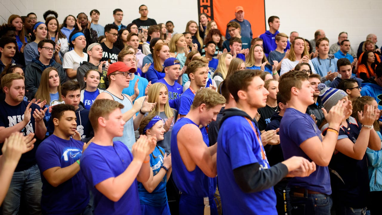 """Northeastern and Dallastown students discuss the importance of Friday night's """"Blue Out"""" in honor of U.S. Marshal Christopher Hill."""