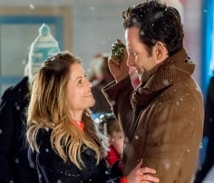 Candace Cameron Bure (with Eion Bailey) plays twin sisters Kate and Chris who switch lives before the Christmas season.