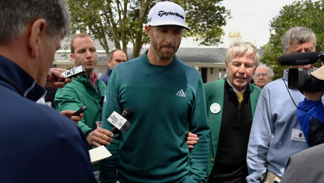Dustin Johnson talks with media after deciding not to play in the opening round of the Masters golf tournament at the Augusta National Golf Club in Augusta, Ga., Thursday, April 6, 2017. The world's No. 1-ranked player was, however, forced to withdraw from the Masters on Thursday because of a lower back injury suffered less than 24 hours earlier in a freak fall at the home he was renting for the week.