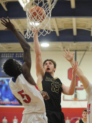 Abilene High's Brian Patton (12) shoots over Cooper's Matthew Falade, left, while Richard Drew looks on. AHS beat the Cougars 66-41 in the nondistrict game Friday, Dec. 15, 2017 at Cougar Gym.
