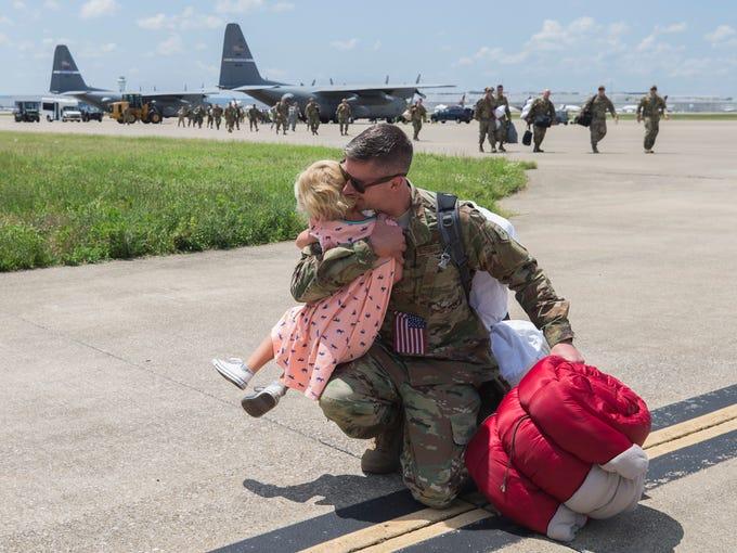 Kentucky Air National Guardsman Braden Sikkema, right,