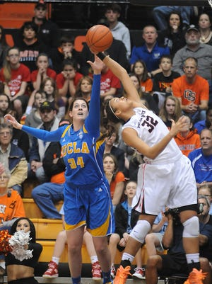 Oregon State's Deven Hunter, right, and UCLA's Corinne Costa, left, chase a rebound  Monday, Feb.  2, 2015, during an NCAA college basketball game in Corvallis.