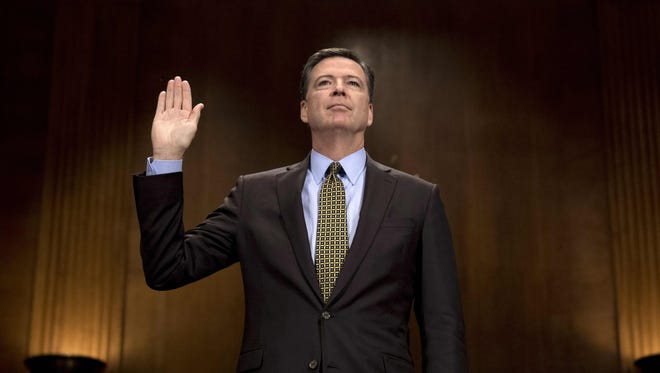 Former FBI director James Comey is sworn in prior to a Senate Judiciary Committee hearing in May.