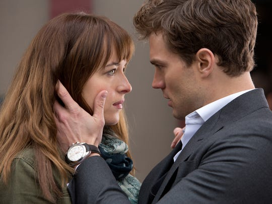 "Dakota Johnson (left) and Jamie Dornan appear in a scene from ""Fifty Shades of Grey."""