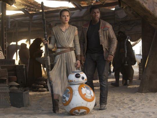 Rey (Daisy Ridley), Finn (John Boyega) and droid BB-8