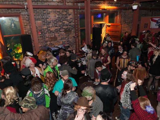 A full house of costumed revelers greeted an all-star