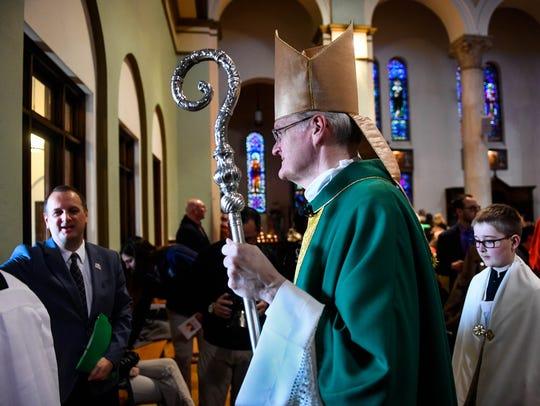 Bishop of Evansville Joseph Siegel exits the Saint