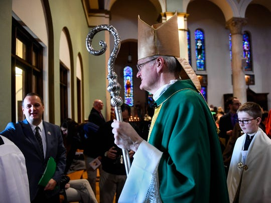 Bishop of Evansville Joseph Siegel exits the Saint Benedict Cathedral after presiding over a Mass celebrating National Schools Week Tuesday. Students from all 26 diocesan Catholic schools attended the Mass, January 30, 2018.