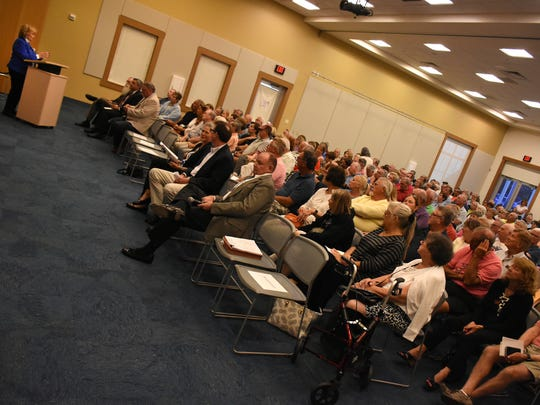 Fiala introduces the session. Collier County Commissioner Donna Fiala held a Town Hall meeting Wednesday evening at the South Regional Library, in a room packed with about 350 constituents and county officials.