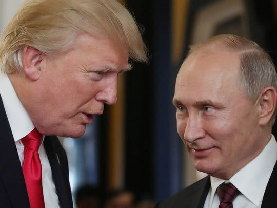In this file photo, President Trump chats with Russian President Vladimir Putin on Nov. 11, 2017 as they attend the APEC Economic Leaders' Meeting, part of the Asia-Pacific Economic Cooperation (APEC) leaders' summit in the central Vietnamese city of Danang.