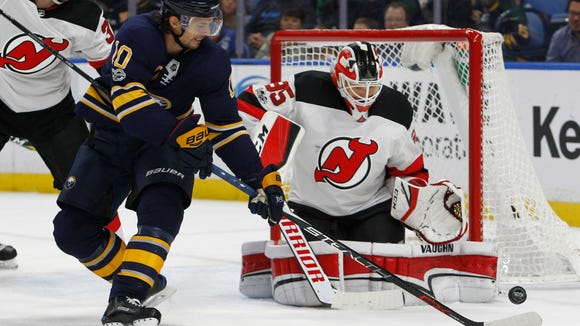 Buffalo Sabres forward Jacob Josefson (10) is stopped by New Jersey Devils goalie Cory Schneider (35) during the first period of an NHL hockey game, Monday Oct. 9, 2017, in Buffalo, N.Y. (AP Photo/Jeffrey T. Barnes)
