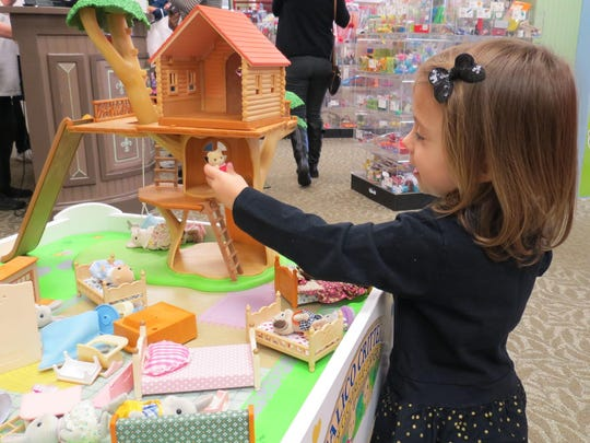 2-year-old Abigail Gaffney of Atco plays while mom shops at The Toy Market during Shop Small Saturday in downtown Hammonton.
