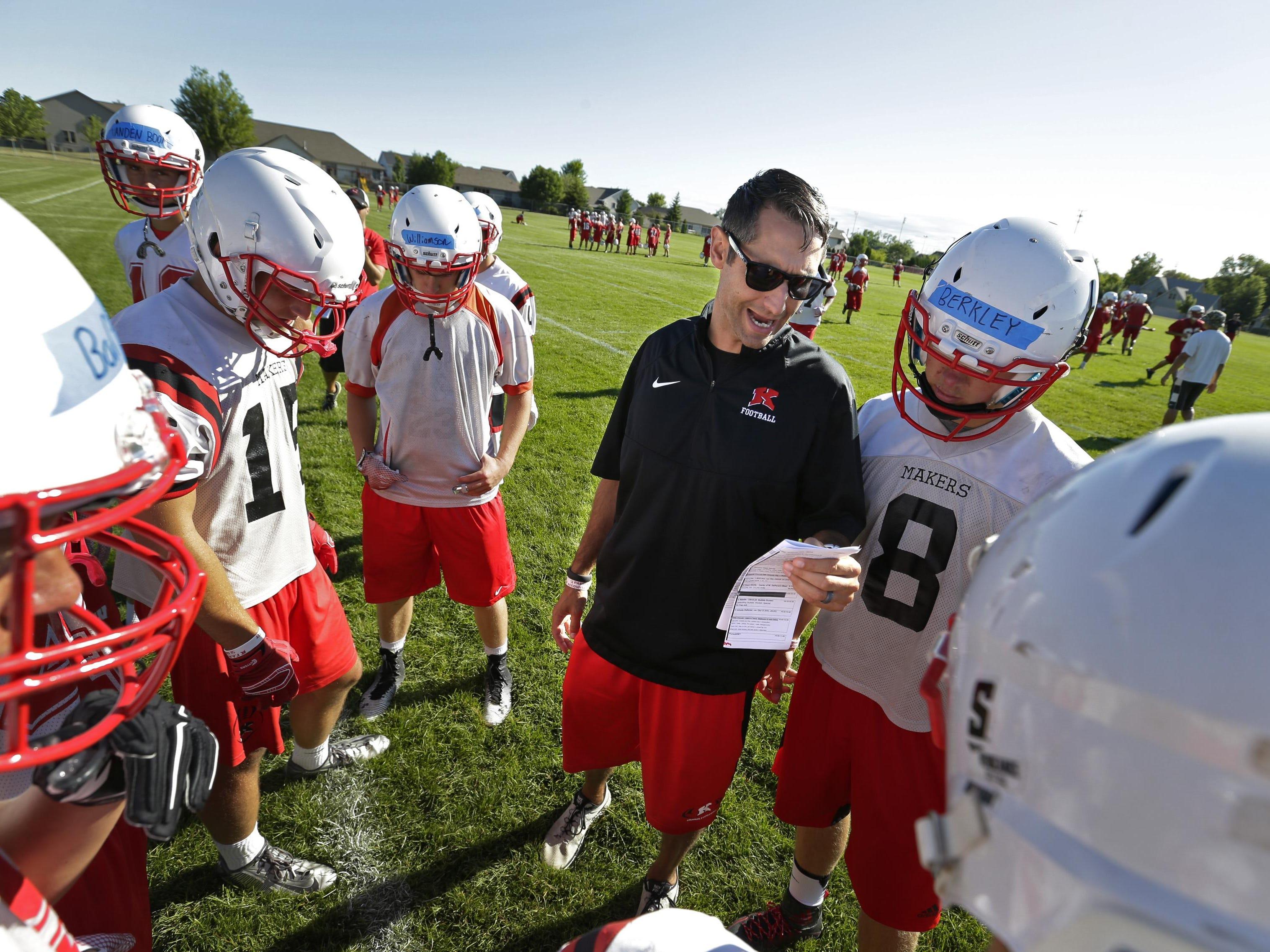Kimberly head coach Steve Jones calls a play for quarterback Ethan Berkley (8) during the first football practice of the season Tuesday.