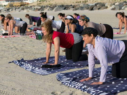 Milo Sutton and her daughter Vera Levy at beach yoga
