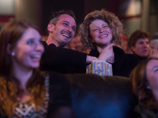 Jeff Abrams and Ra•ssa Huntley react to comments from candidates during the final presidential debate shown at the Lyric Cinema Cafe in Fort Collins on Oct. 19.