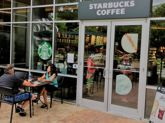 From left, Starbucks regulars Walker and Dam Reeps of Piedmont visit the North Main Street store on Tuesday morning, May 29, 2018. The store, which is a franchise, will close at 3 p.m. Tuesday for biannual training that will include discussions about customer service and sensitivity to diversity, said Dirk Bengel, general manager of the Hyatt Regency.