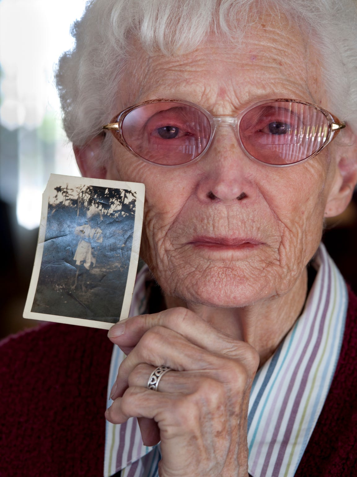 Anna Leak, 90, of Tulare holds a photograph of herself taken about 1930. She's holding a chicken in the picture.