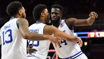 Mar 15, 2018; Wichita, KS, USA; Seton Hall Pirates players Myles Powell (13) , Desi Rodriguez (20) and Ismael Sanogo (14) celebrate after defeating the North Carolina State Wolfpack in the first round of the 2018 NCAA Tournament at INTRUST Bank Arena.