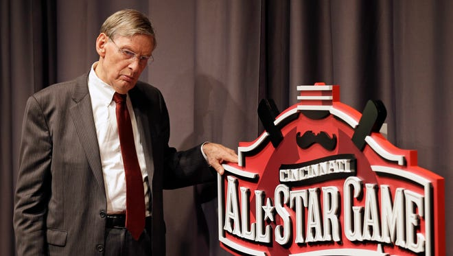 Baseball commissioner Bud Selig answers questions at a news conference in Cincinnati.