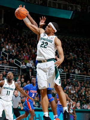 Michigan State's Miles Bridges (22) pulls down a rebound against Savannah State during the first half of an NCAA college basketball game, Sunday, Dec. 31, 2017, in East Lansing, MI