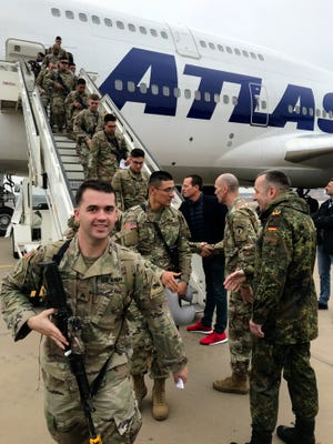 U.S. ambassador in Germany Richard Grenell, center back ground, welcomes soldiers from the 1st Armored Division, based in Fort Bliss, Texas, at Tegel airport in Berlin, Germany, March 21, 2019. Over three hundred soldiers have arrived in Germany from their base in Texas in the first test of a new American strategy to rapidly deploy troops based in the United States to Europe to bolster the NATO deterrent against possible Russian aggression.