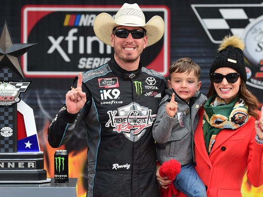 Kyle Busch poses with his wife, Samantha, and son, Brexton, after winning Saturday's NASCAR Xfinity Series race at Texas Motor Speedway.