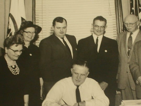 In this 1963 photograph, Governor George Romney, surrounded