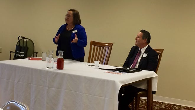 Democratic challenger Julie Stewart and Republican incumbent Mark Hanson participate in a Waukee Chamber of Commerce candidate forum. They're running to represent District 2, which covers Des Moines' western suburbs, Dallas Center and portions of Adel.
