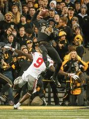 Iowa cornerback Josh Jackson intercepts an Ohio State pass in the fourth quarter at Kinnick Stadium on Saturday, Nov. 4, 2017, in Iowa City.