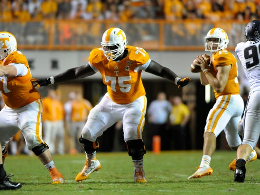 In this Aug. 31, 2014, photo, Tennessee offensive lineman Marcus Jackson (75) provides pass protection during a NCAA football game against Utah State in Knoxville, Tenn. Jackson will undergo potential season-ending surgery, leaving the Volunteers without the most experienced member of an offensive line that allowed the most sacks in the Southeastern Conference last year. . (AP Photo/Knoxville News Sentinel, Michael Patrick)