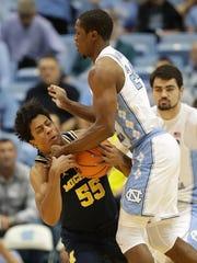 North Carolina's Kenny Williams Tar Heels collides with Michigan's Eli Brooks on Wednesday, Nov. 29, 2017, in Chapel Hill, N.C.