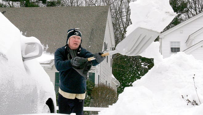 Gregg Smith shovels out after a heavy snowfall in the Boston suburb of  Marlborough, Mass.,  Monday, Dec. 27, 2010. Big snowstorms may not necessarily decrease due to global warming.
