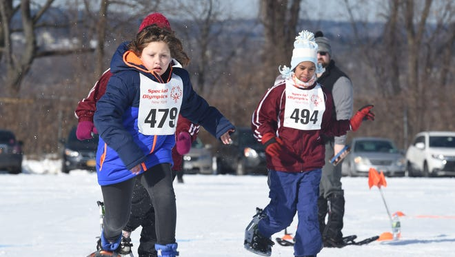 Aurora Jones, left, of the Southern Tier Region, competes in a snowshoeing race alongside Mya Torres, right, of the Western Region during the 2017 Special Olympics New York Winter Games at Bowdoin Park in Wappingers Falls.