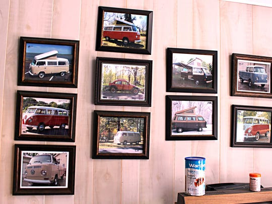 Inside Barry Shelden's shop, he has photos of some of the VW buses he has fixed up over the years.