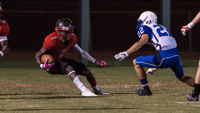 Bennett's Jahryn Long (1) runs the ball during a game against North Caroline on Friday, Oct. 20, 2017.