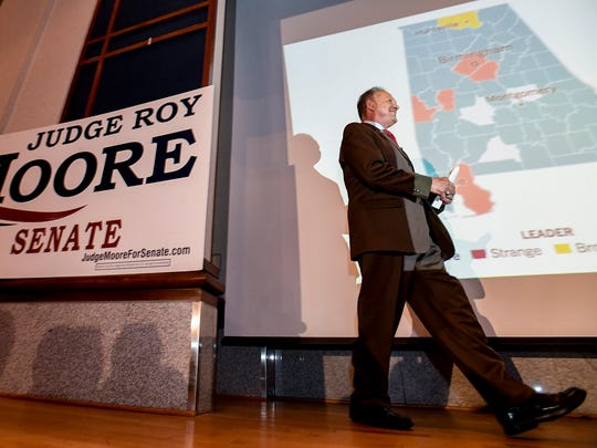 U.S. Senate candidate Roy Moore takes the stage to speak during his election watch party at the Alabama Activity Center in downtown Montgomery, Ala., on Tuesday August 15, 2017.
