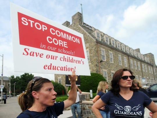 Karoline Mahoskey-Cardone of Hopewell Junction, left, Deborah Torres Henning of Stormville, right, and others protest against the Common Core in Poughkeepsie as state Education Commissioner John King is interviewed by the Poughkeepsie Journal Editorial Board.
